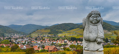 Andlau, Alsace village, vineyard, statue of monk carrying wine barrel