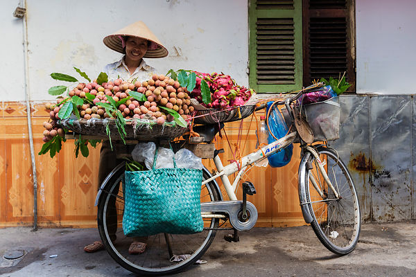 Fruit Seller with her Bicycle