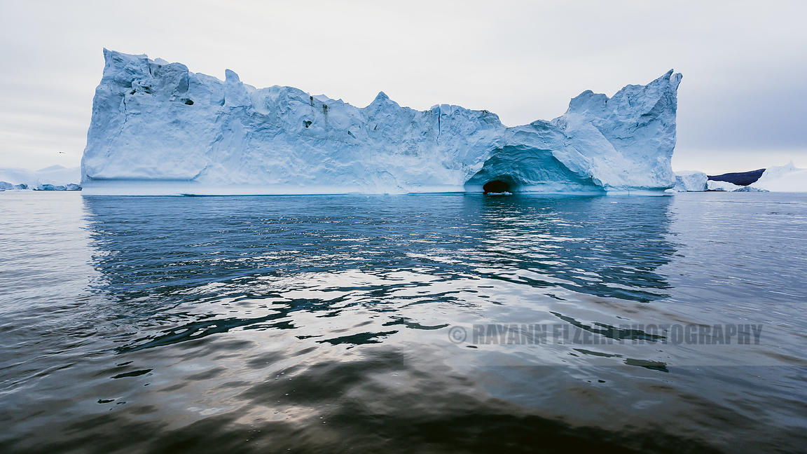 A cave formed when some ice collapsed in this iceberg in the Ilulissat Icefjord