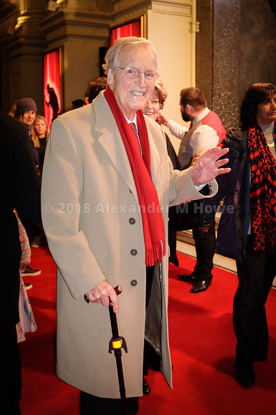 Nicholas Parsons (1923-2020) smiles at the camera outside the London Palladium Theatre.