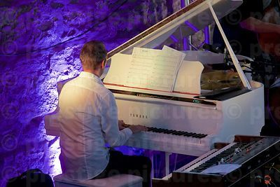 Old Stone Built Music Venue with Piano Player Performing on a White Piano