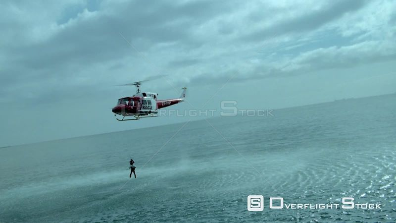 Aerial of men being airlifted out of the sea Cape Town Western Cape South Africa