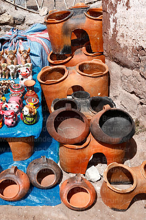 Stall selling ceramic ovens in Chinchero market, Sacred Valley, Peru