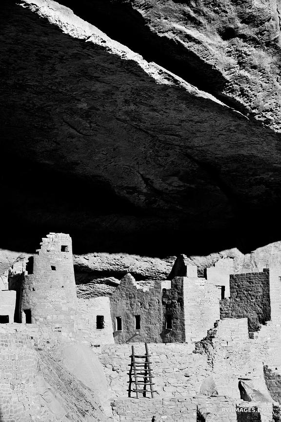 BLACK AND WHITE MESA VERDE CLIFF PALACE RUINS ANCESTRAL PUEBLOAN CLIFF DWELLING ARCHEOLOGICAL SITE BLACK AND WHITE VERTICAL