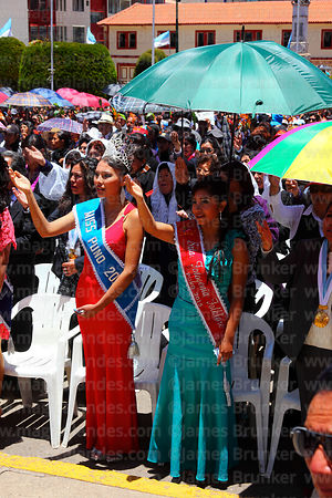 Beauty queens saying Ave Marias after central mass, Virgen de la Candelaria festival, Puno, Peru