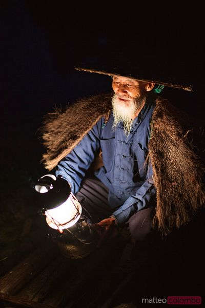 Old chinese fisherman with lantern, China