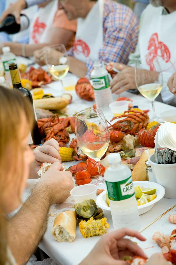 Guests enjoy a winery lobster feed party with Napa Valley wine