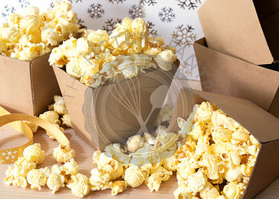 Maple butter popcorn in small cardboard boxes.