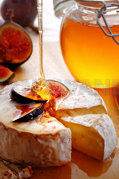 Brie Cheese with Figs pored with honey