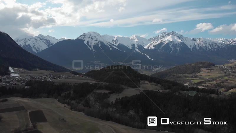 Aerial shot of Tyrolean mountain villages with Alps in background in Pitztal, Tyrol, Austria