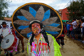 A member of La Caprichosa devil dancers group wearing a Mexican sombrero takes part in parades during Carnival, San Lorenzo, ...