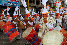 Suri sicuris group playing sicus or panpipes and bombo banda drums, Virgen de la Candelaria festival, Puno, Peru