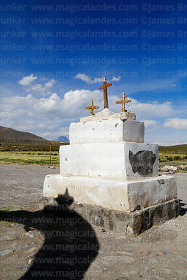 Cairn with 3 crosses in front of Santo Tomás church, Isluga village, Isluga National Park, Region I, Chile