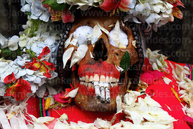 Close up of skull with dentures smoking cigarettes, Ñatitas festival, La Paz, Bolivia