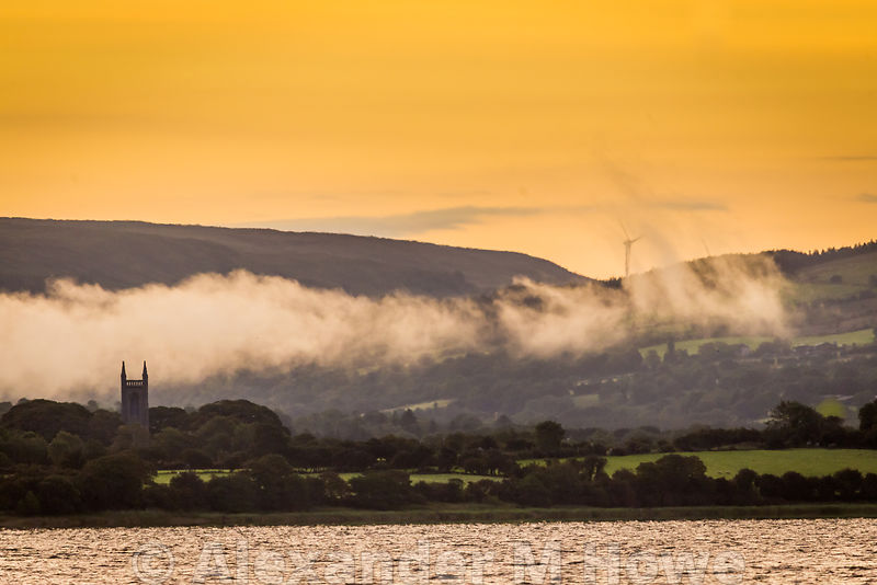 Sunrise over Carney village with low level fog over the parish church