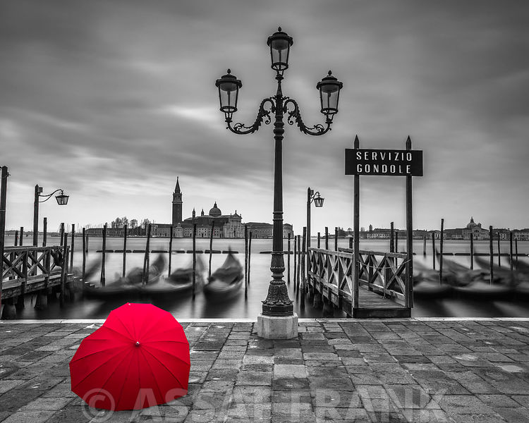 Heart shaped umbrella next to lamp post at Gondola hiring point, Venice, Italy