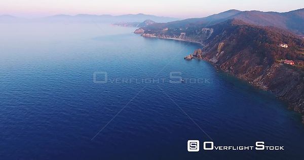 Aerial shot of beautiful sunset on the calm sea in Elba island in Tuscany, Italy, 4K