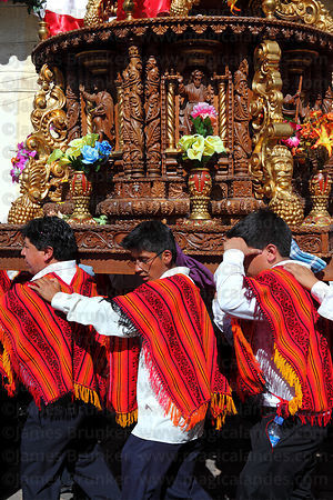 Bearers carrying figure of San Blas during Corpus Christi festival , Cusco , Peru