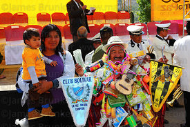 People pose for photos with Ricardo Paco (the official ekeko) at the Alasitas festival, La Paz, Bolivia