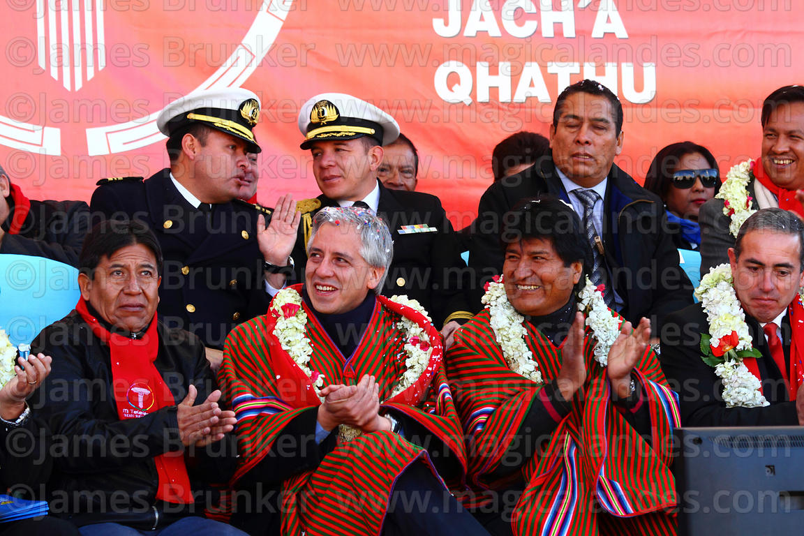 Bolivian president Evo Morales (left) and vice president Alvaro Garcia Linera (centre) applaud during the cable car Red Line ...