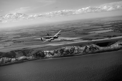 Lancaster over the white cliffs in Kent black and white version