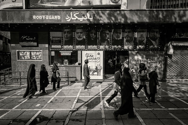 People Walking in a Street in Tehran