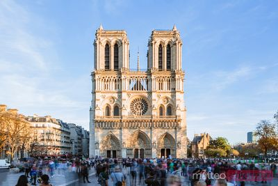 Notre Dame cathedral with tourists, Paris, France