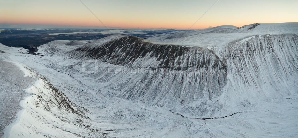 Aerial view above the Lairig Ghru pass at sunrise, Cairngorms National Park, Scotland, UK, November 2016.