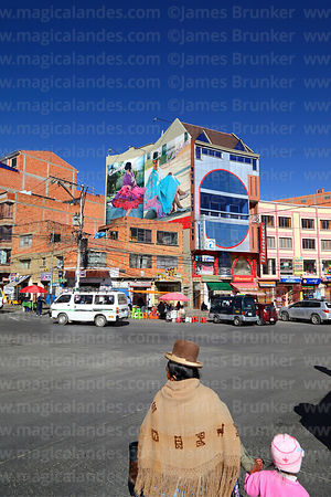 Street scene and adverts for Cholita Collection fashion campaign on wall of building, El Alto, Bolivia