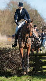 Zoe Gibson jumping the first hedge