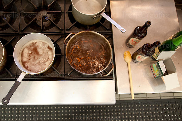 Sauces simmering in pots on the stove top