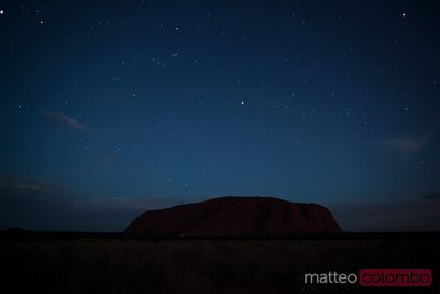 Uluru under the stars at night Australia