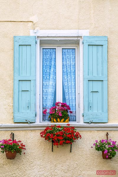 Detail of a window with flowers, Provence, France