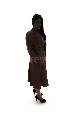 A silhouette of a 1940's woman in a coat – shot from eye-level.