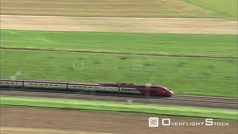 TGV Thalys passenger train speeding through a village in Belgium
