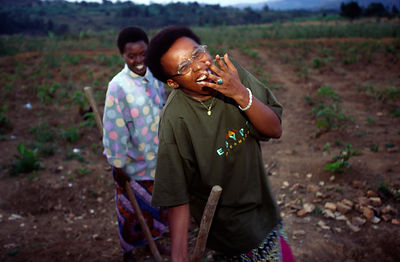 Burundi - Ruyigi - Maggie Barankitse laughing as she helps to cultivate the fields