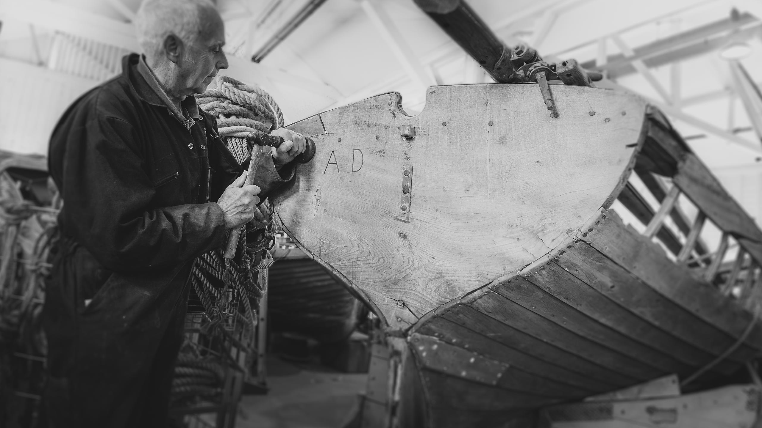 Volunteer Boat Restorers at Work at Boathouse 4, in the Portsmouth Historic Dockyard