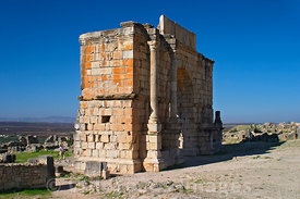 The Triumphal Arch over the Decumanus built 217 AD, rebuilt 1930 AD, corrected 1960 AD, Volubilis, Morocco; Landscape