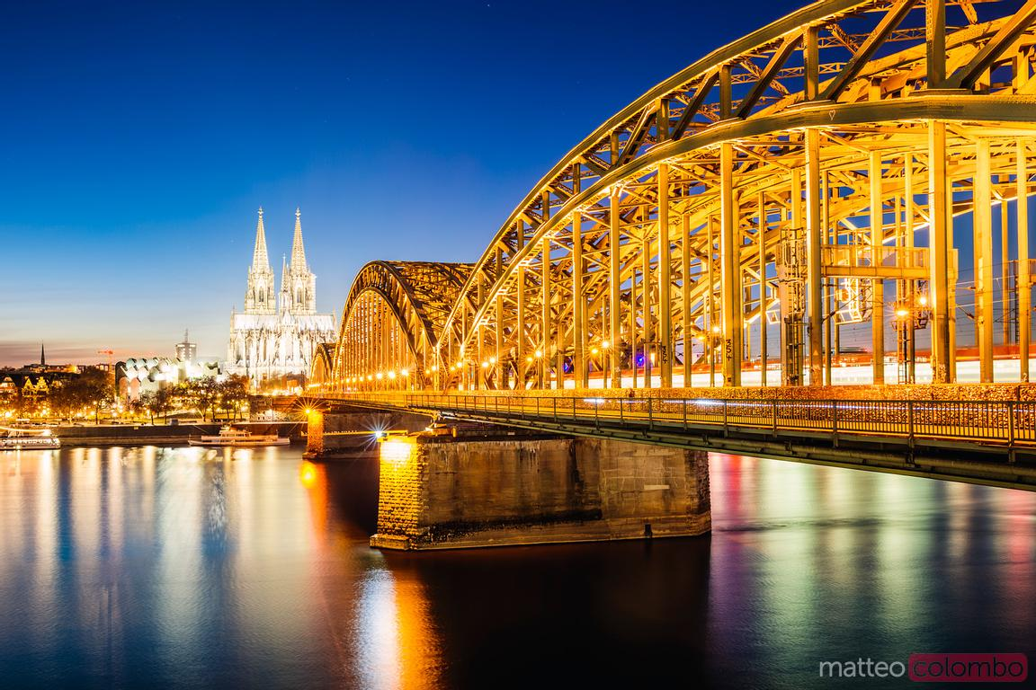 Hohenzollern Bridge and cathedral at night, Cologne
