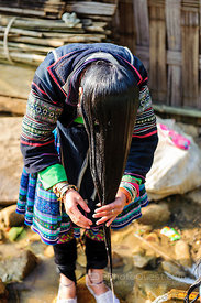 Young Black Hmong Woman Washing Hair
