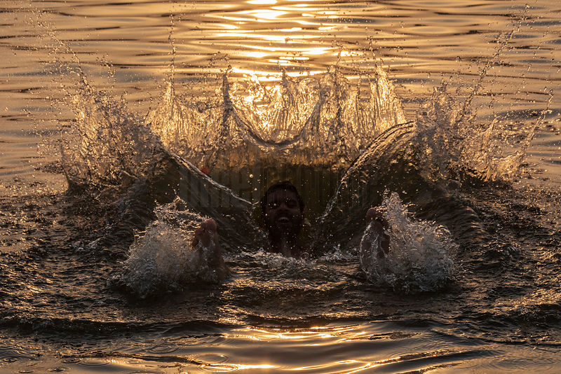 Man Taking a Holy Dip in the River Ganges
