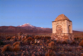 Cairn on hilltop at twilight, Guallatiri volcano in background, Las Vicuñas National Reserve, Region XV, Chile