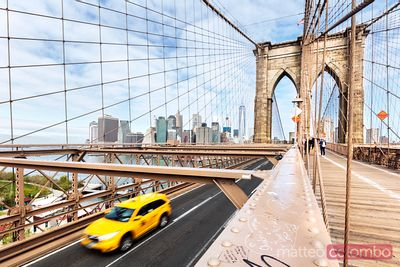Yellow cab passing on Brooklyn bridge, New York, USA