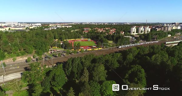 Train in a City, Aerial Tracking View of Lots of Trains Following Leaving the Railway Station, in Helsinki, on a Sunny Summer...