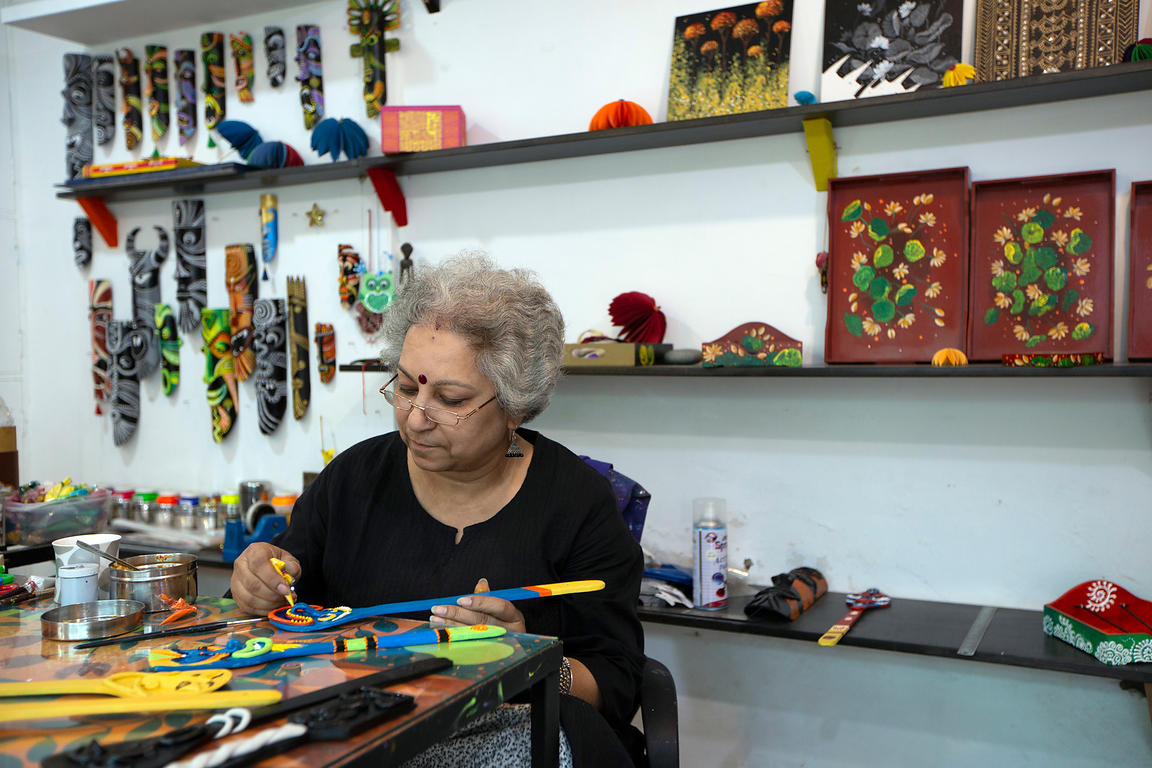 Rekha Bhal painting one of her art pieces in her shop Rem and Rekha, Champa Gali, New Delhi, India