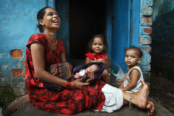 A mother and her three children in the Fakir Bagan area of Howrah, India