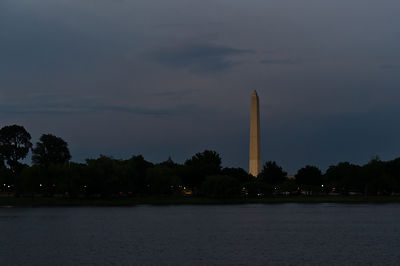 The Washington Monument lit up at dusk on a Potomac River cruise in Washington DC.