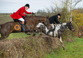 Russell Cripps and  Robin Smith Ryland jumping a hedge at Town Farm