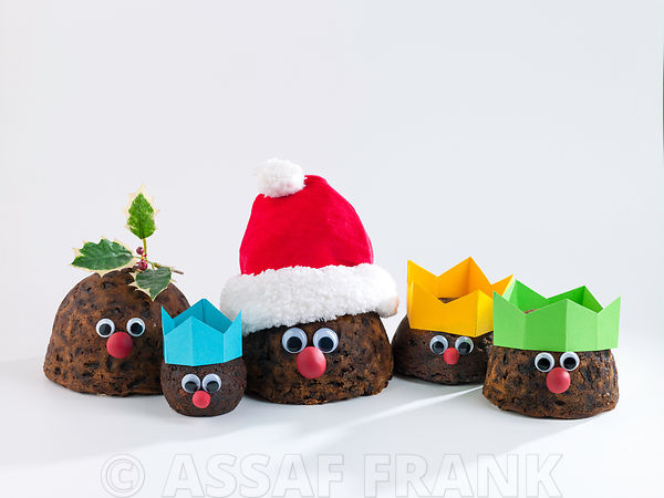 Christmas puddings with christmas hat on white background