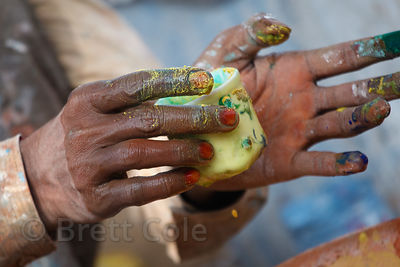 Mixing paint for a mural in Pushkar, Rajasthan, India